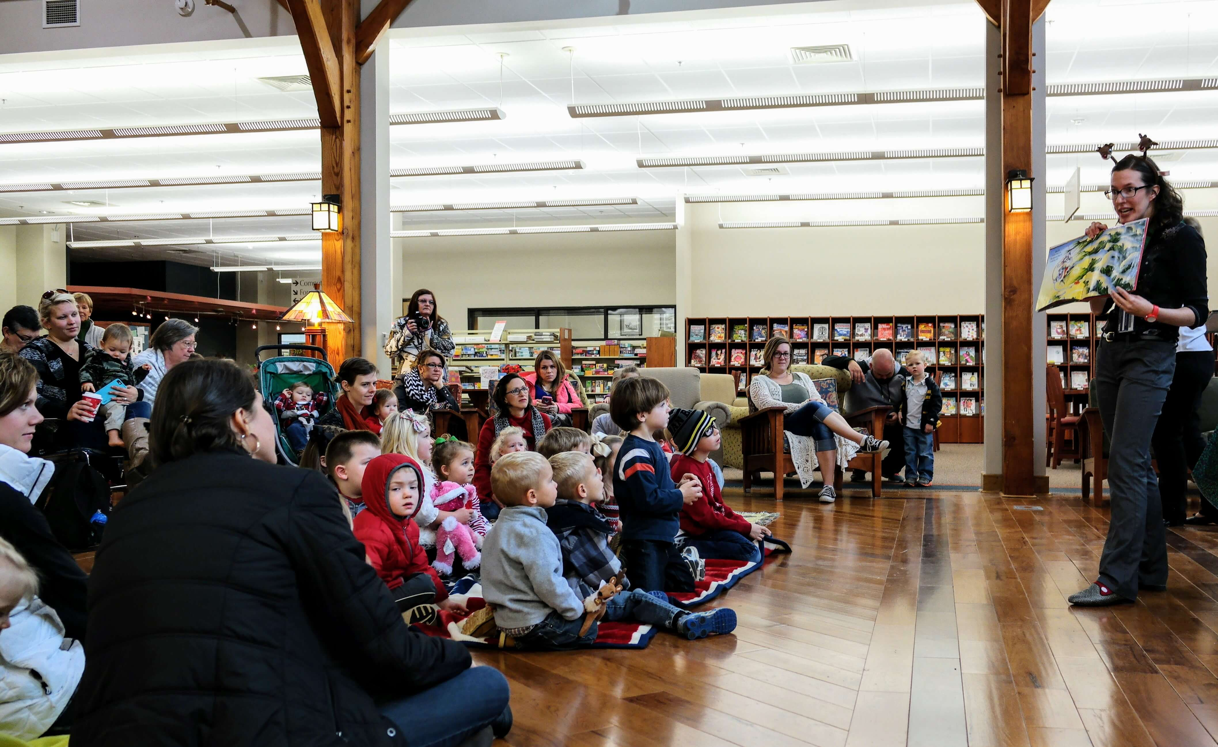 Children sang songs and read stories to celebrate the holidays